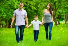 Full-length portrait of happy family of three Stock Photography