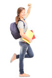 Full length portrait of a happy female teenage student Stock Photos