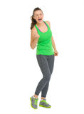 Full length portrait of happy fitness woman rejoicing success Royalty Free Stock Photo