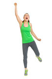 Full length portrait of happy fitness woman rejoicing success Stock Photo