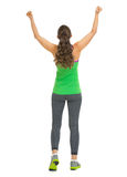 Full length portrait of happy fitness woman rejoicing success Stock Photography