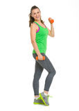 Full length portrait of happy fitness young woman with dumbbells Stock Photos