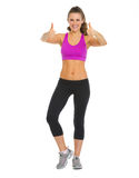 Happy fitness young woman showing thumbs up Royalty Free Stock Photos