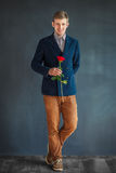 Full length portrait of happy handsome man with red rose Stock Images