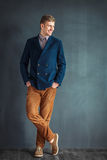 Full length portrait of happy handsome young man Royalty Free Stock Image
