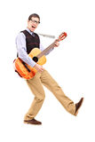 Full length portrait of a happy male playing a guitar Royalty Free Stock Images