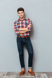 Full length portrait of a happy man with arms folded Stock Photography