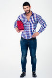 Full length portrait of a happy man holding gift box. Isolated on a white background Royalty Free Stock Photography