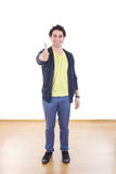 Full length portrait of happy man standing showing thumbs up Royalty Free Stock Photo
