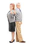 Full length portrait of a happy mature couple giving thumbs up Stock Photo