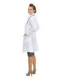Full length portrait of happy medical doctor woman Stock Photos