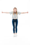 Full length portrait of a happy pretty girl screaming Royalty Free Stock Photos