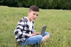 Young guy having fun with notebook stock photos