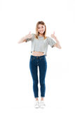 Full length portrait of a happy smiling girl standing Royalty Free Stock Photography