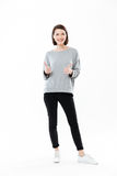 Full length portrait of a happy smiling girl standing Stock Images
