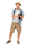 Full length portrait of happy tourist photographer man on white Stock Images