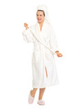 Full length portrait of happy woman in bathrobe Stock Photos