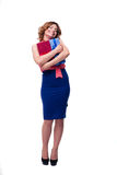 Full length portrait of a happy woman holding gifts Royalty Free Stock Image
