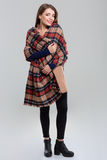Full length portrait of a happy woman with plaid. Standing isolated on a white background Stock Photos