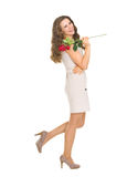 Full length portrait of happy woman with red rose Stock Photo