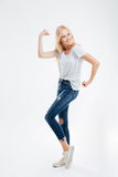Full length portrait of a happy woman showing her muscles Royalty Free Stock Image