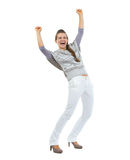 Full length portrait of happy woman in sweater rejoicing success Stock Photo