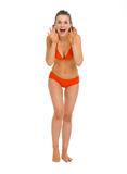 Full length portrait of happy woman in swimsuit Stock Image
