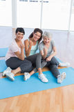 Full length portrait of happy women in yoga class Stock Photos