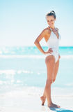 Full length portrait of happy young woman on beach Stock Photos