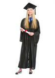 Happy young woman in graduation gown with diploma Stock Photography