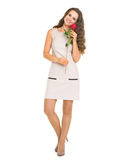 Full length portrait of happy young woman holding red rose Royalty Free Stock Photography