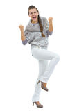 Full length portrait of happy young woman making fist pump gesture Stock Photos