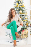 Full length portrait of happy young woman near christmas tree Royalty Free Stock Photos