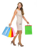 Happy young woman with shopping bags. Full length portrait of happy young woman with shopping bags Royalty Free Stock Photo