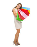 Full length portrait of happy young woman with shopping bags Stock Image