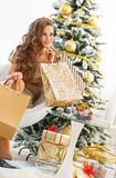 Full length portrait of happy young woman with shopping bags Royalty Free Stock Images