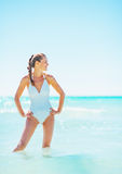 Full length portrait of happy young woman standing in sea Stock Images
