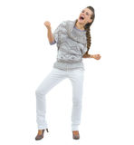 Full length portrait of happy young woman in sweater dancing Royalty Free Stock Photography