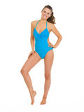 Full length portrait of happy woman in swimsuit. Full length portrait of happy young woman in swimsuit royalty free stock images