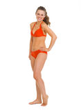 Full length portrait of happy young woman in swimsuit Royalty Free Stock Photography