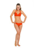 Full length portrait of happy young woman in swimsuit Stock Photography