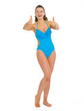 Full length portrait of happy woman in swimsuit Royalty Free Stock Photo