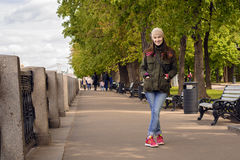 Full length portrait of happy young woman walking with dogs outdoors in autumn royalty free stock photo