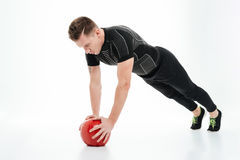 Full length portrait of a healthy athlete man doing exercises stock photos