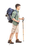 Full length portrait of a hiker with backpack and hiking poles w stock photos