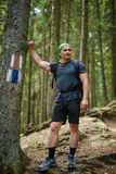 Full length portrait of a hiker in the woods Royalty Free Stock Photo