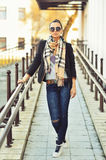 Full length portrait of hipster girl in urban scene Royalty Free Stock Images