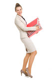 Full length portrait of holding stack of folders Royalty Free Stock Photos