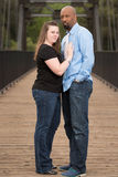 Full length portrait of interracial couple. Stock Image