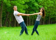 Full-length portrait of joining hands couple Stock Photo